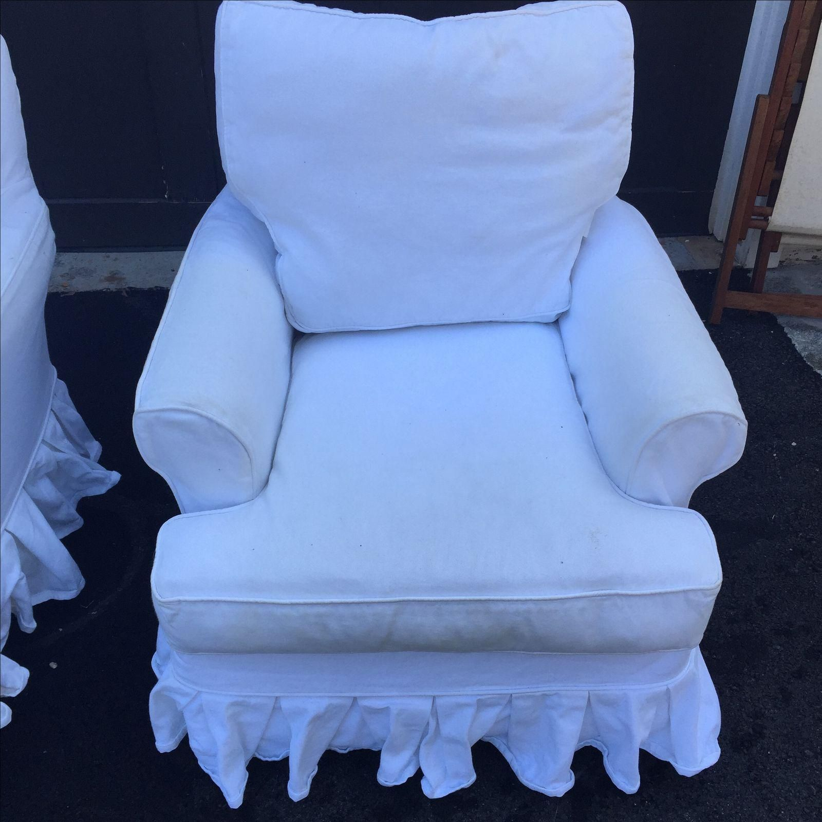 Image Of White Slip Covered Skirted Swivel Chairs