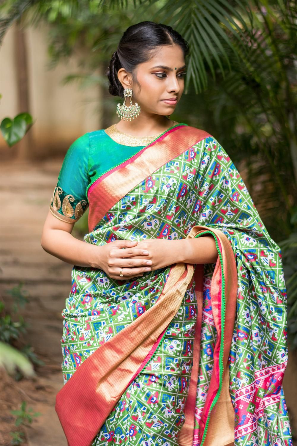 Tissue silk saree green and pink patola inspired semi silk saree with a rich tissue