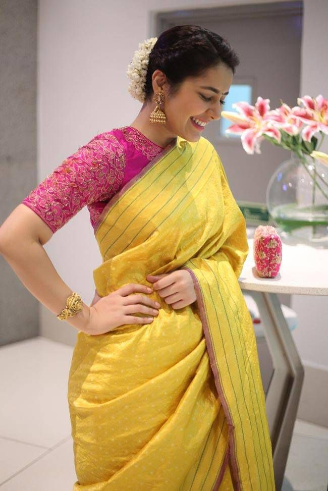 35997379eb5fb5 Rashi Khanna Smiling Stills In Yellow Saree At Director Krish Marriage
