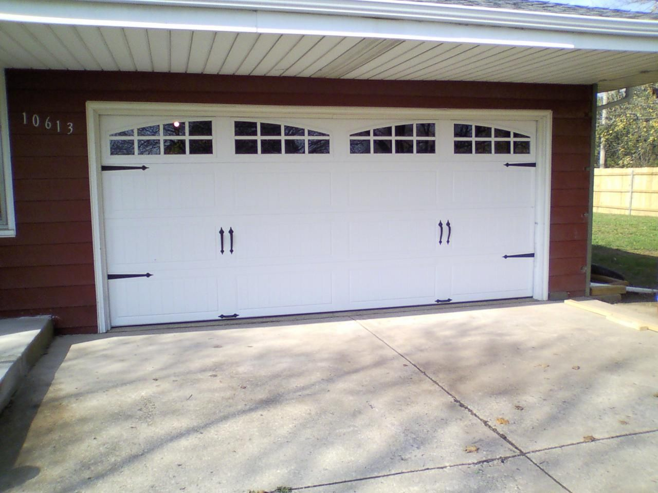 Garage door swing hinges - Four Sets Of Symmetrical Iron Strap Hinges On Tongue And Groove Bead Board Give