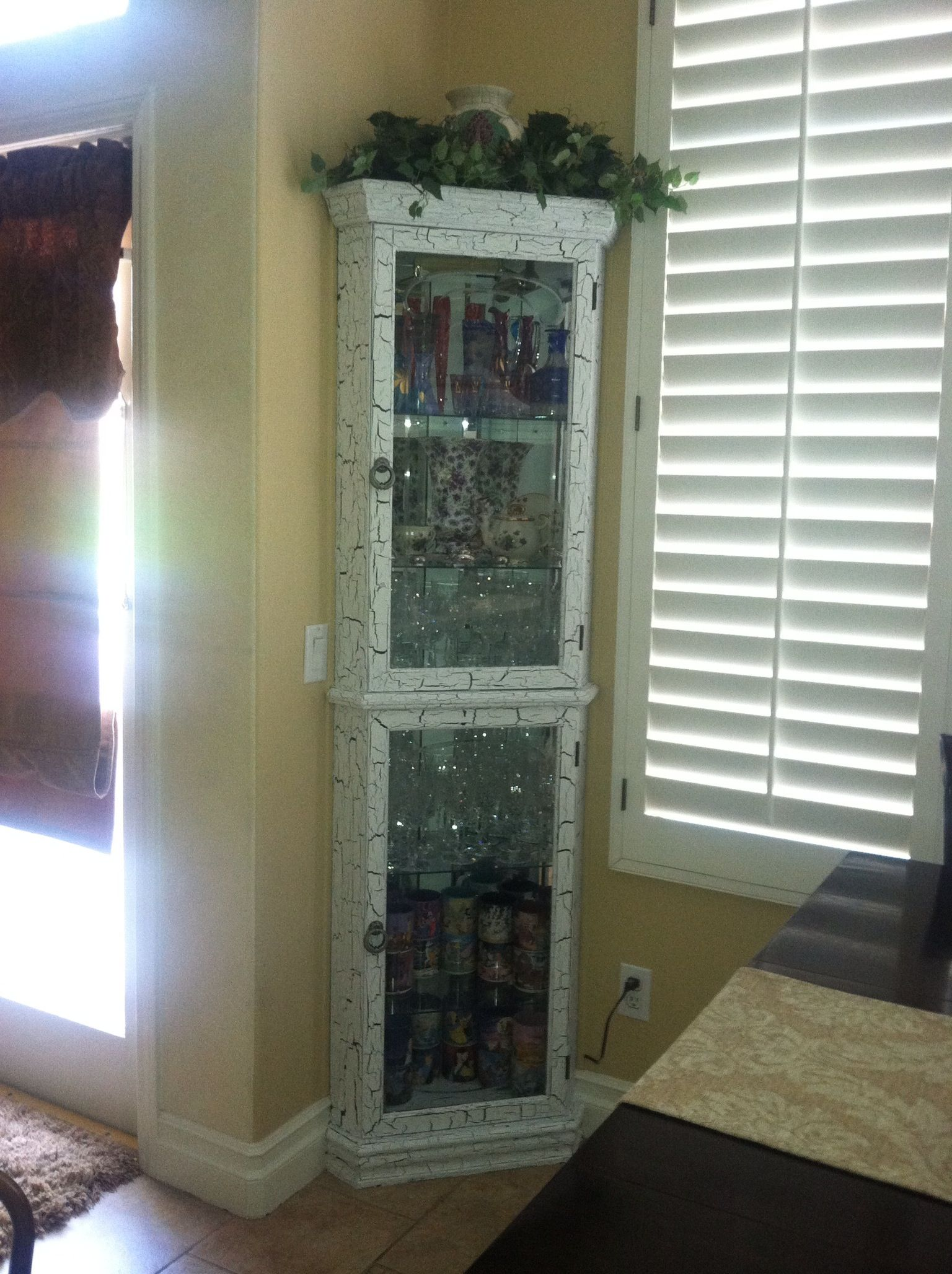 I crackle painted the oak laminate corner cabinet in my ...