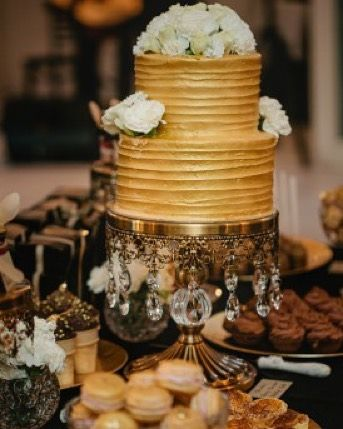 gold and black dessert buffet with gold buttercream wedding cake and fresh flowers #reginercakes #weddingcake #wedding #weddingcakes #weddingmelbourne #weddingcakes #weddingcakemelbourne #weddingcakesmelbourne #dessert #dessertcake #dessertweddingcake #dessertweddingcakemelbourne #dessertbuffet #dessertbuffetmelbourne #golddesserttable #golddessertbuffet #desserttablemelbourne how amazing are these photo form @ellenitoumpasweddings for our dessert buffet we did @thewillowsevents perfect