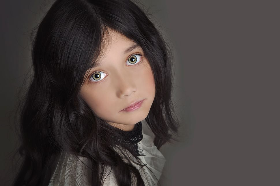 little girl with black hair and blue eyes elsy
