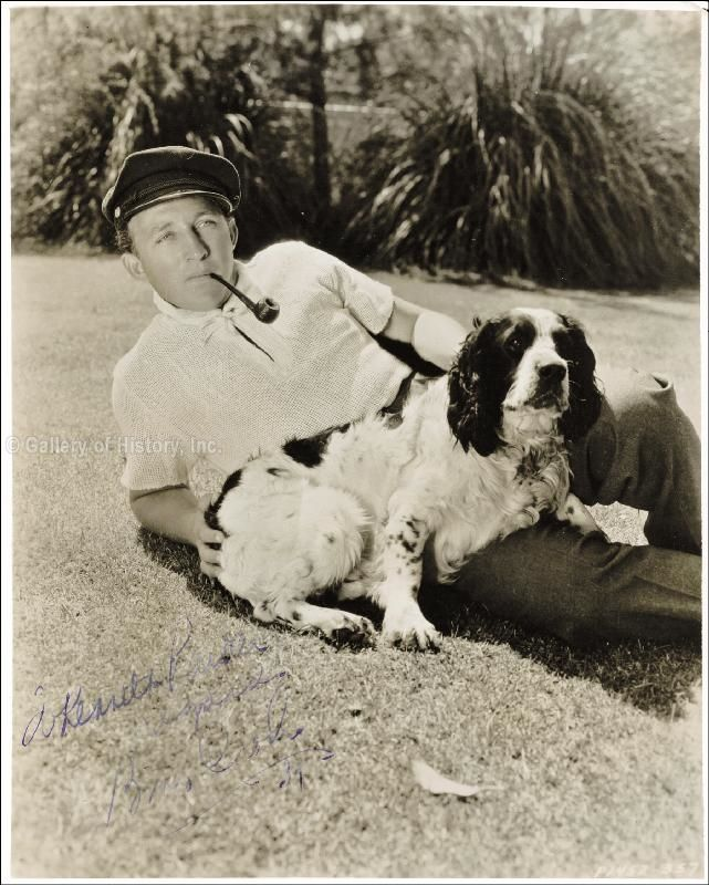 0 Bing Crosby poses for a portrait with a pipe and a dog