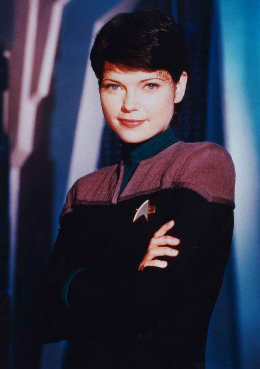 Ezri Dax was a joined Trill and the ninth host of the Dax symbiont. She served as counselor aboard Deep Space 9, beginning in 2375. She was joined to Dax shortly after the death of its previous host, Jadzia.