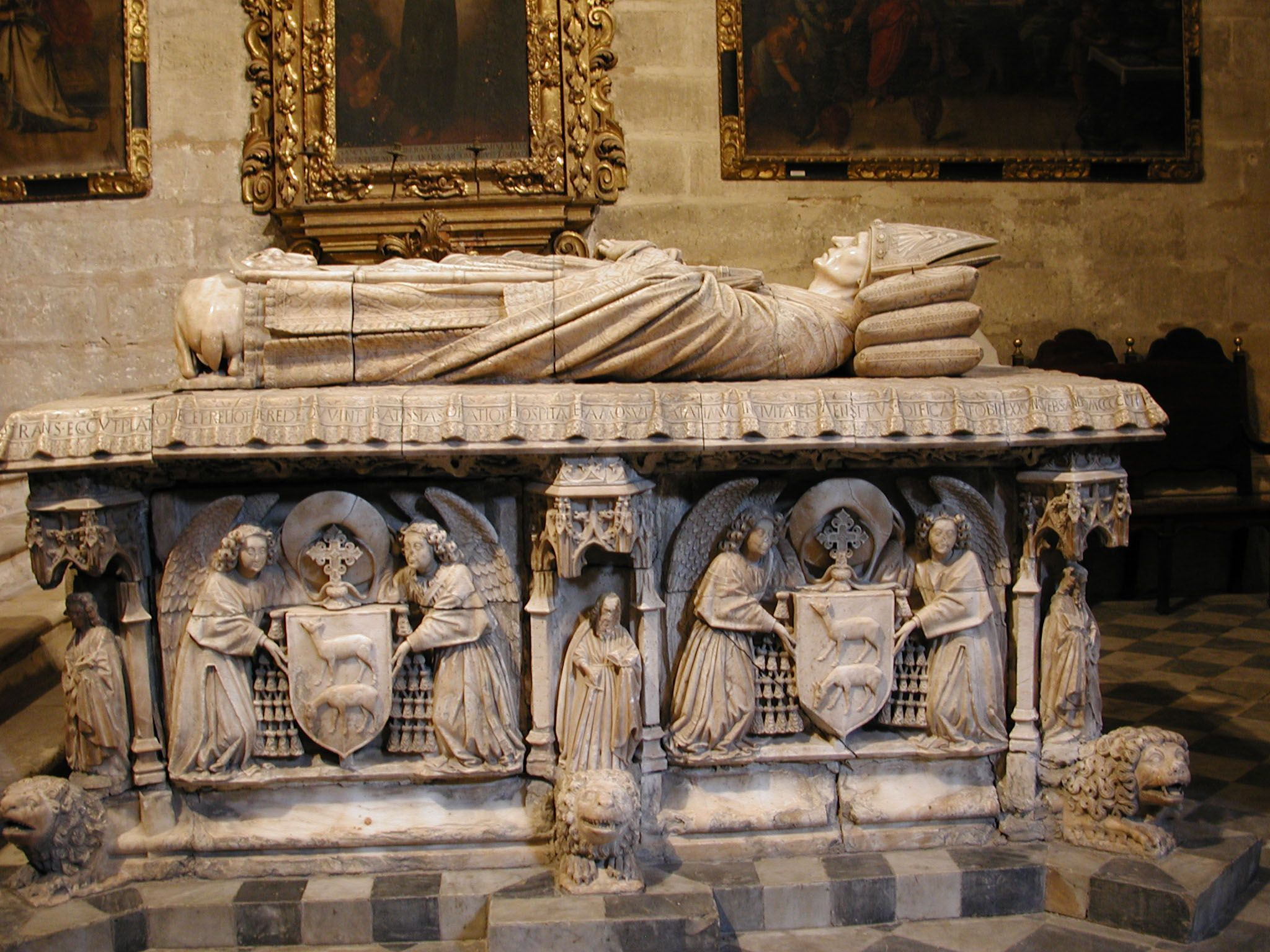 Tomb of Cardinal Juan de Cervantes - Seville Cathedral, Spain - Cervantes studied at theUniversity of Salamanca - hewas appointed Archdeacon of Seville and Procurator of the King of Castile to the Roman Curia in 1419. In 1452 he tried to negotiate peace between England and France. He was an important man hence this important tomb - MuseumPlanet.com - Tours on your iPad
