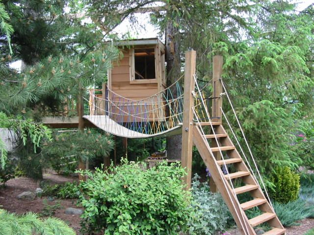 Fancy Tree House, Stairs, Rope Bridge And A Deck Before Getting Inside.