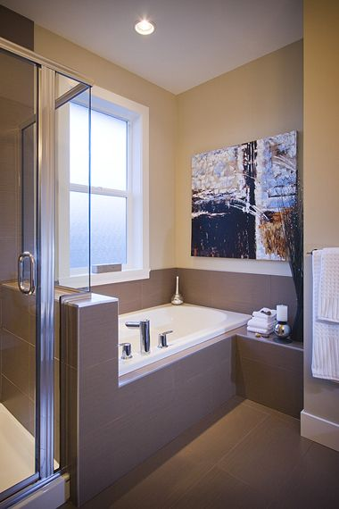 Separate tub and shower with rich tile surrounds ...