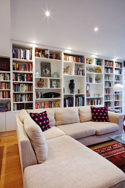 Living Room Library Design Ideas: An Oversized White Bookcase With Additional Lights Take