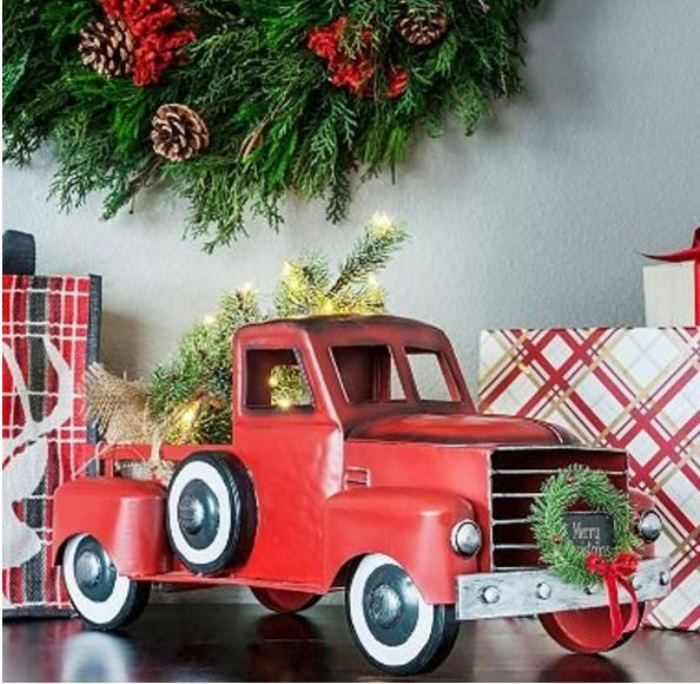 adorable red christmas truck station wagon with tree wreath