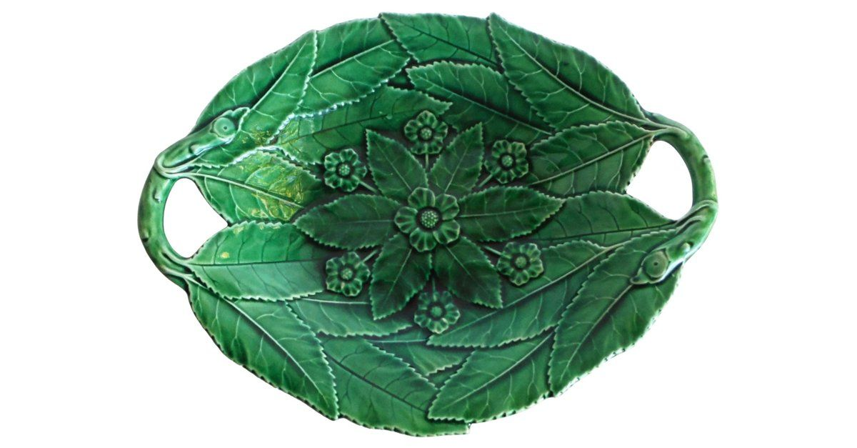 Antique 19th-century English green majolica platter with flower and leaves. Hanging hardware included.