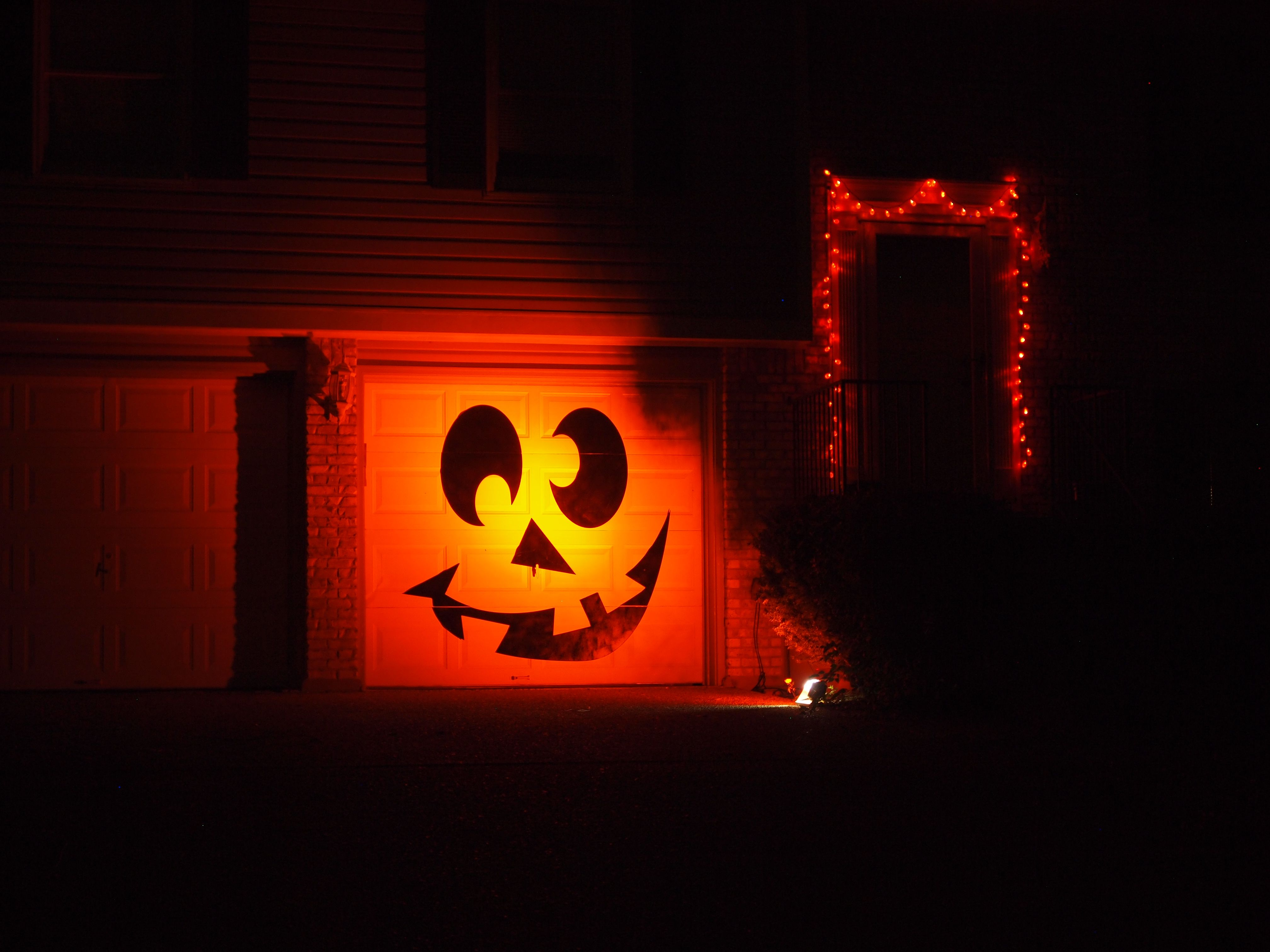 Halloween Decorations 2013 - Laser cut hardboard painted black and mounted on garage door. Illuminated by a LED floodlight with an orange filter. & Halloween Decorations 2013 - Laser cut 1/8