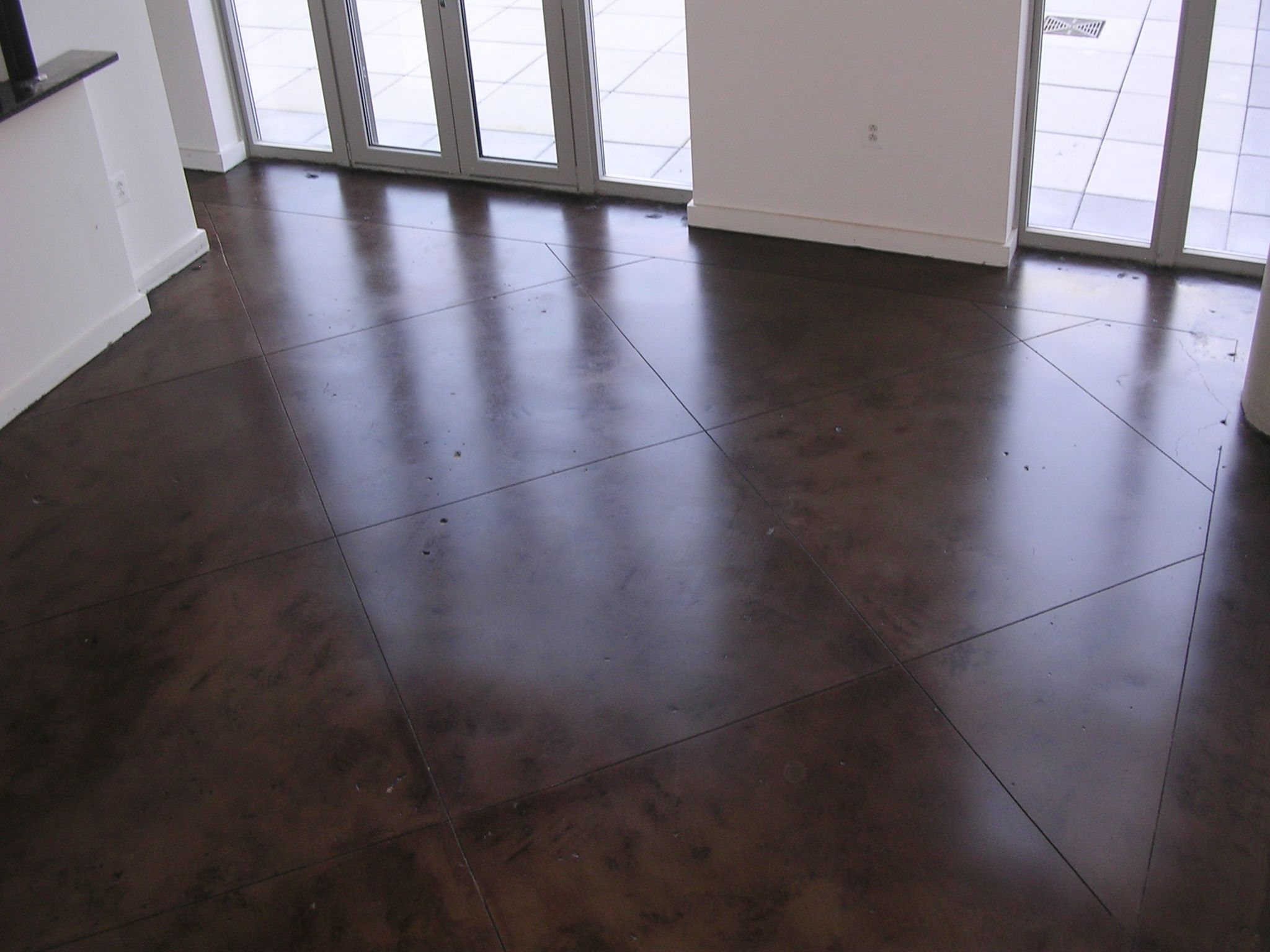 Concrete floors in home simple with photos of concrete for Stained polished concrete floor
