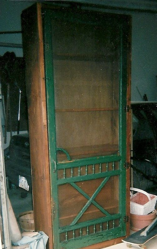 Old Screen Door Mounted To Book Shelves To Make Sewing