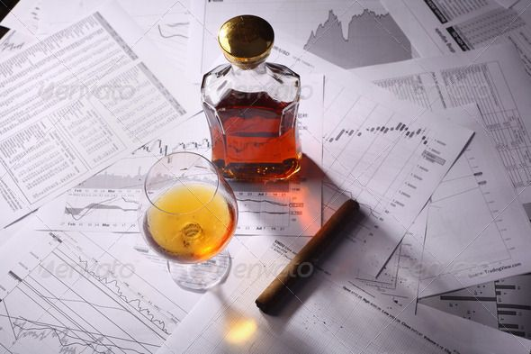 Brandy and cigar on charts ...  alcohol, amber, analysis, brandy, business, caustic, celebration, charts, cigar, cognac, drink, glass, market, paper, reports, rest, risk, smoking, snifter, stock exchange, stress, success, tobacco, trading. stress management, warm