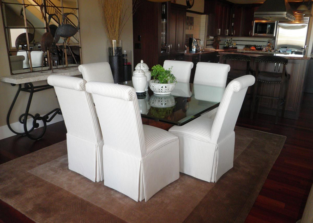 Skirted Parsons Chairs Around A Glass Table The Chairs Contrast Perfectly With The Earth Tone Colors Of The Dining Room Style Living Room Decor Apartment Home