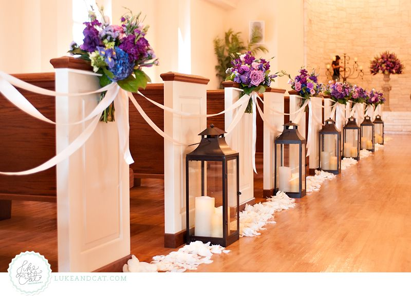 Pew Lanterns Ribbons And Purple Flowers Flowers By The