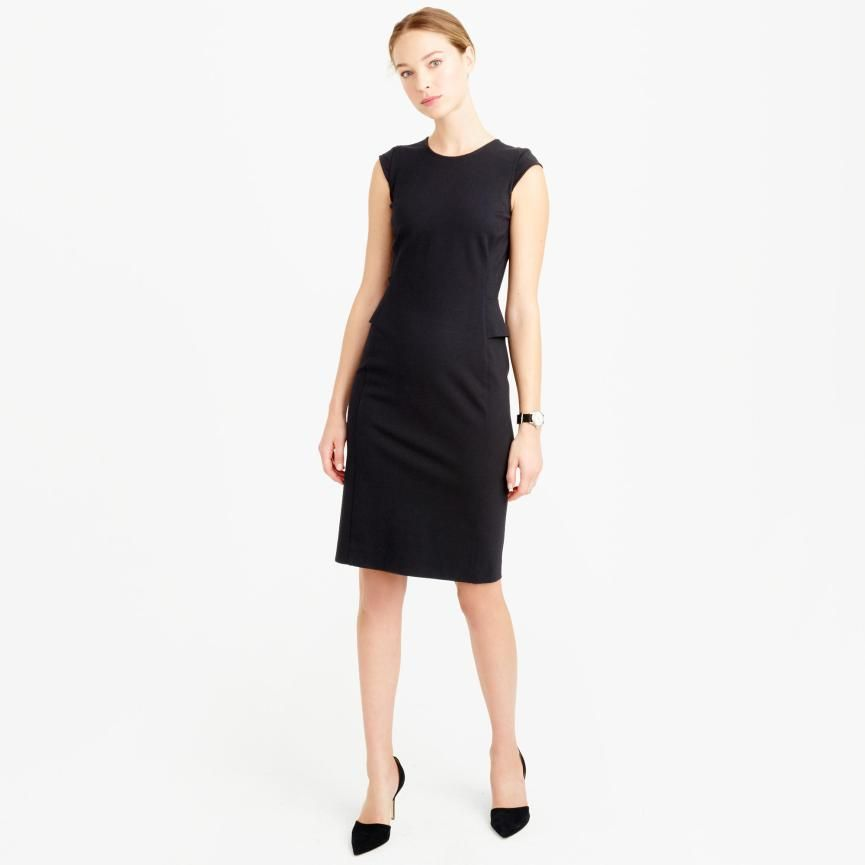 woman wearing black interview dress on skirt the ceiling