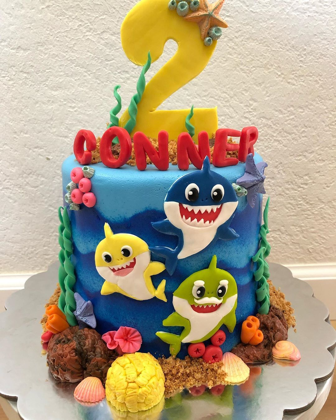 Yoruwai Studio On Instagram Latepost Baby Shark Cake And Cupcakes For Conner S 2nd Bir Shark Birthday Cakes Shark Themed Birthday Party Shark Birthday Party
