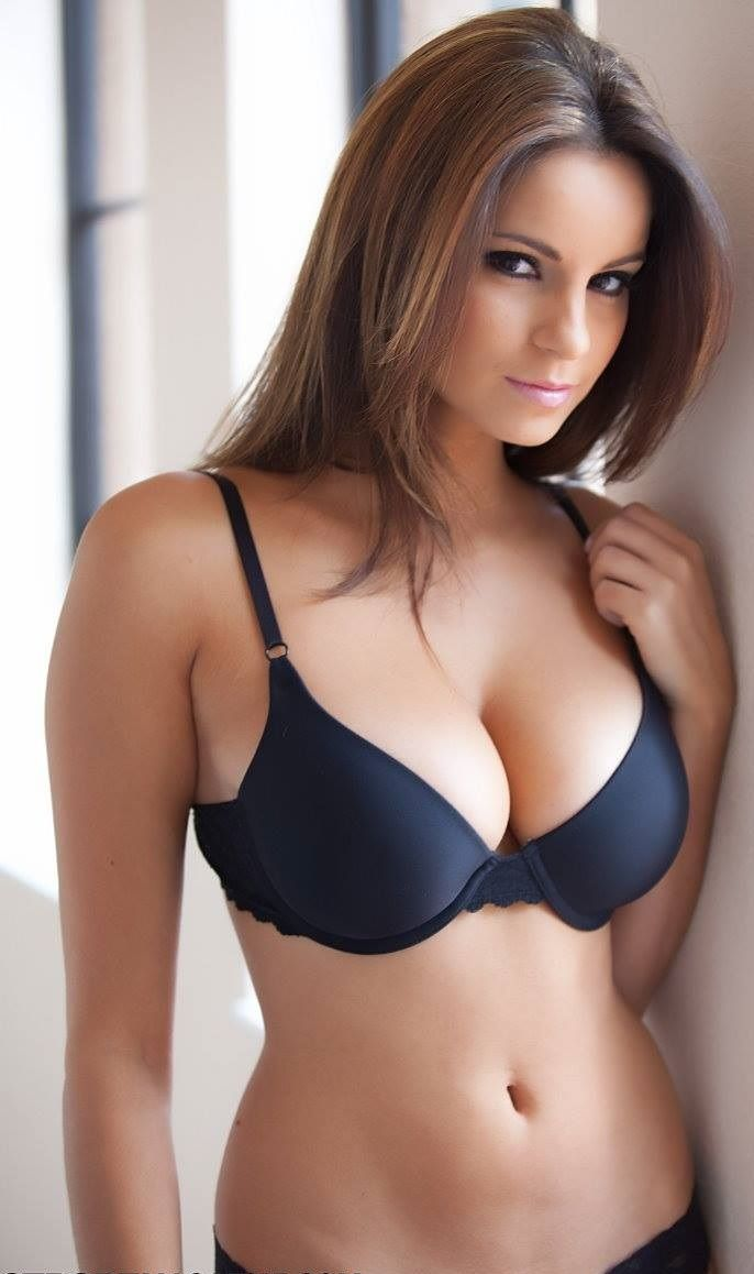 Beautiful girl with sexy breasts in jacket and beauty hair