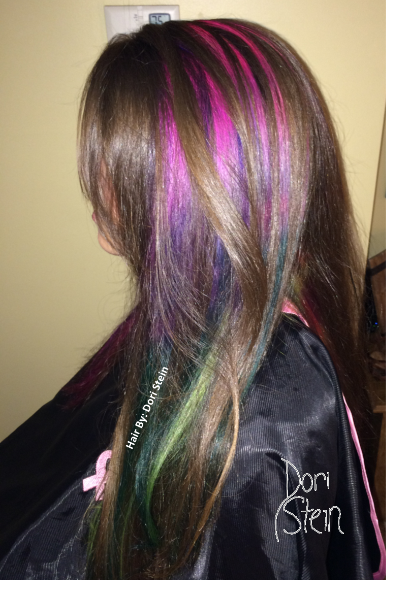 Natural hair with fun pink blue yellow purple and red highlights