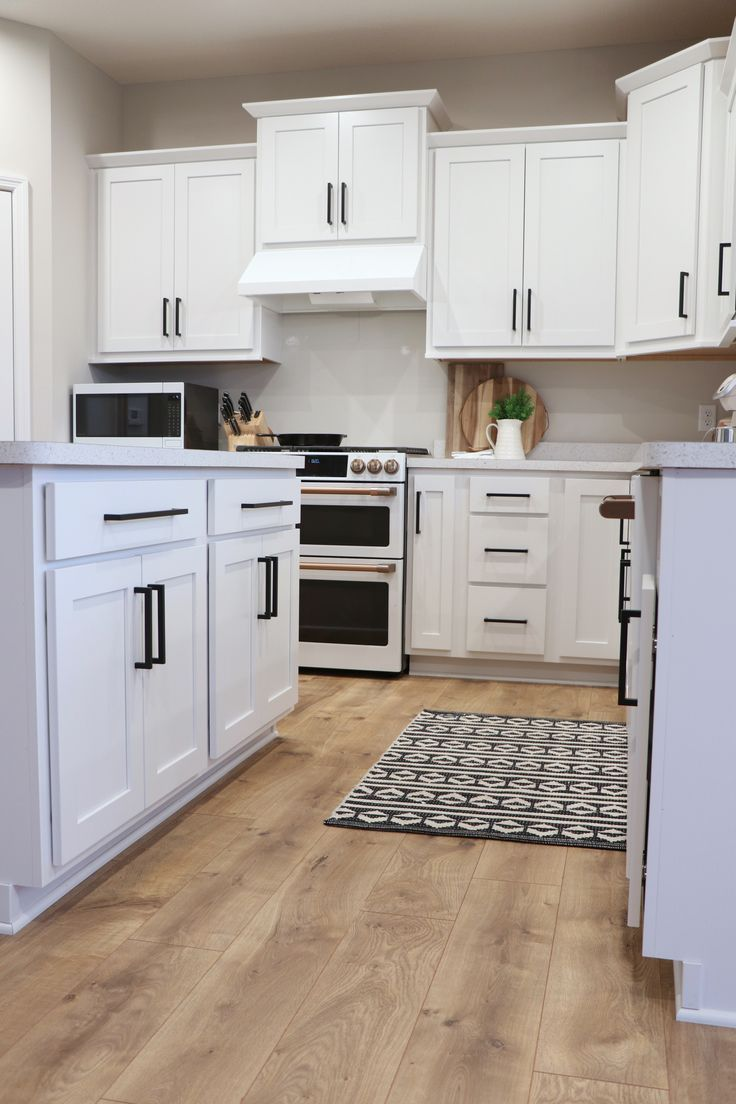 Modern Farmhouse Kitchen With White Cabinets And Black Hardware