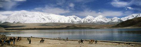 Tourists Horseback Riding at the Lakeside, Muztagh Ata, Karakul Lake, Xinjiang Province, China Photographic Print by Panoramic Images at AllPosters.com