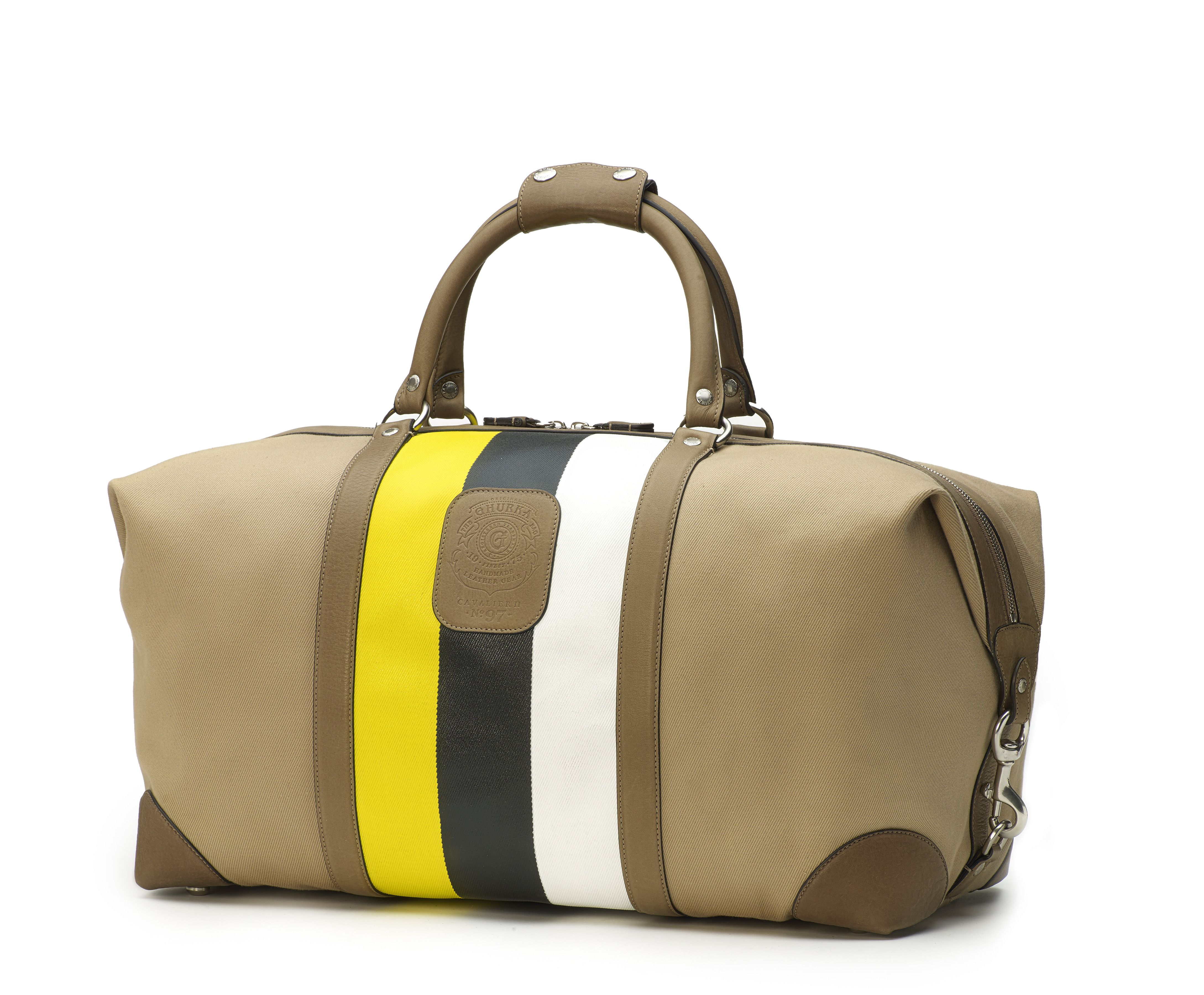 Ghurka offers the best duffel bags for the travelers we all aspire to be: adventurous, elegant, innovative. Our versatile mid-size duffel bag features fold-end design that opens to allow extra room and ease of packing. The perfect weekend carry-on bag, the Cavalier II No. 97 comes in rich chestnut leather, with our signature checked fabric lining and brass hardware. This designer duffel bag is functional, sophisticated, and classic.