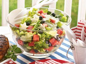 Put a colorful and tasty spin on a traditional green salad by tossing in jicama, watermelon and blueberries with a creamy yogurt dressing.