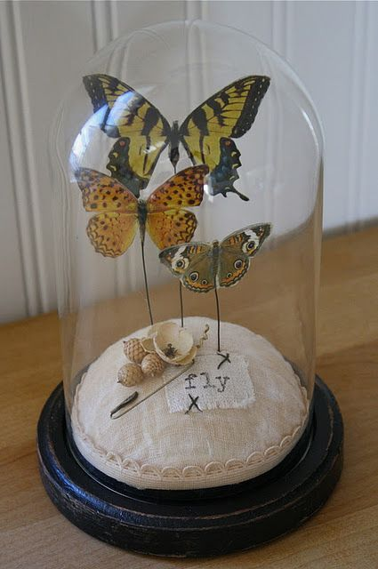 Great summer project.  Love the way she created the butterflies by applying rub-ons directly to packaging plastic...so much potential for that idea!