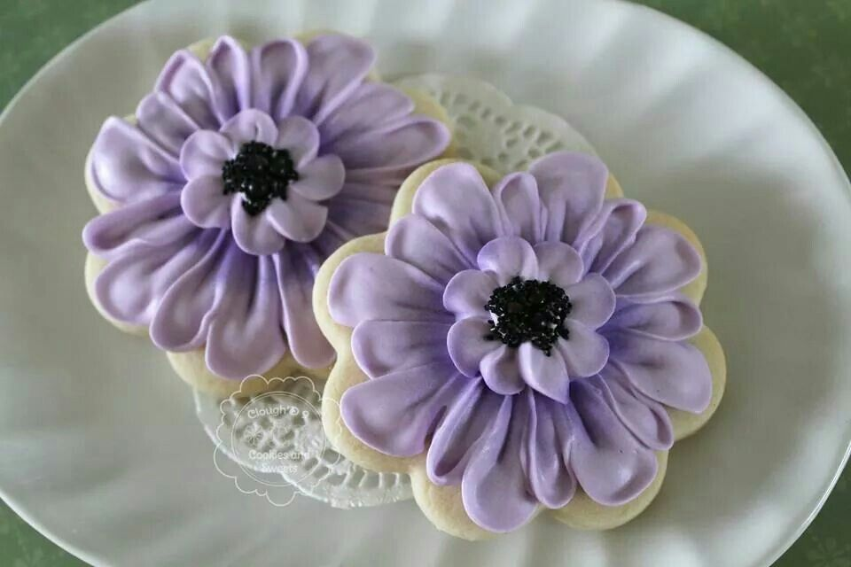 Purple flowers piped with royal icing by Clough D9 Cookies.....