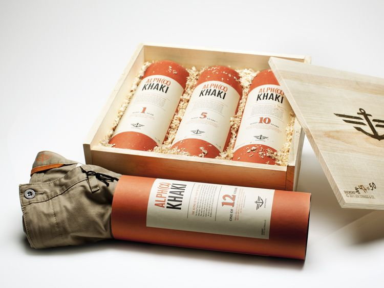 Khaki pants in packaging that looks like whiskey or scotch