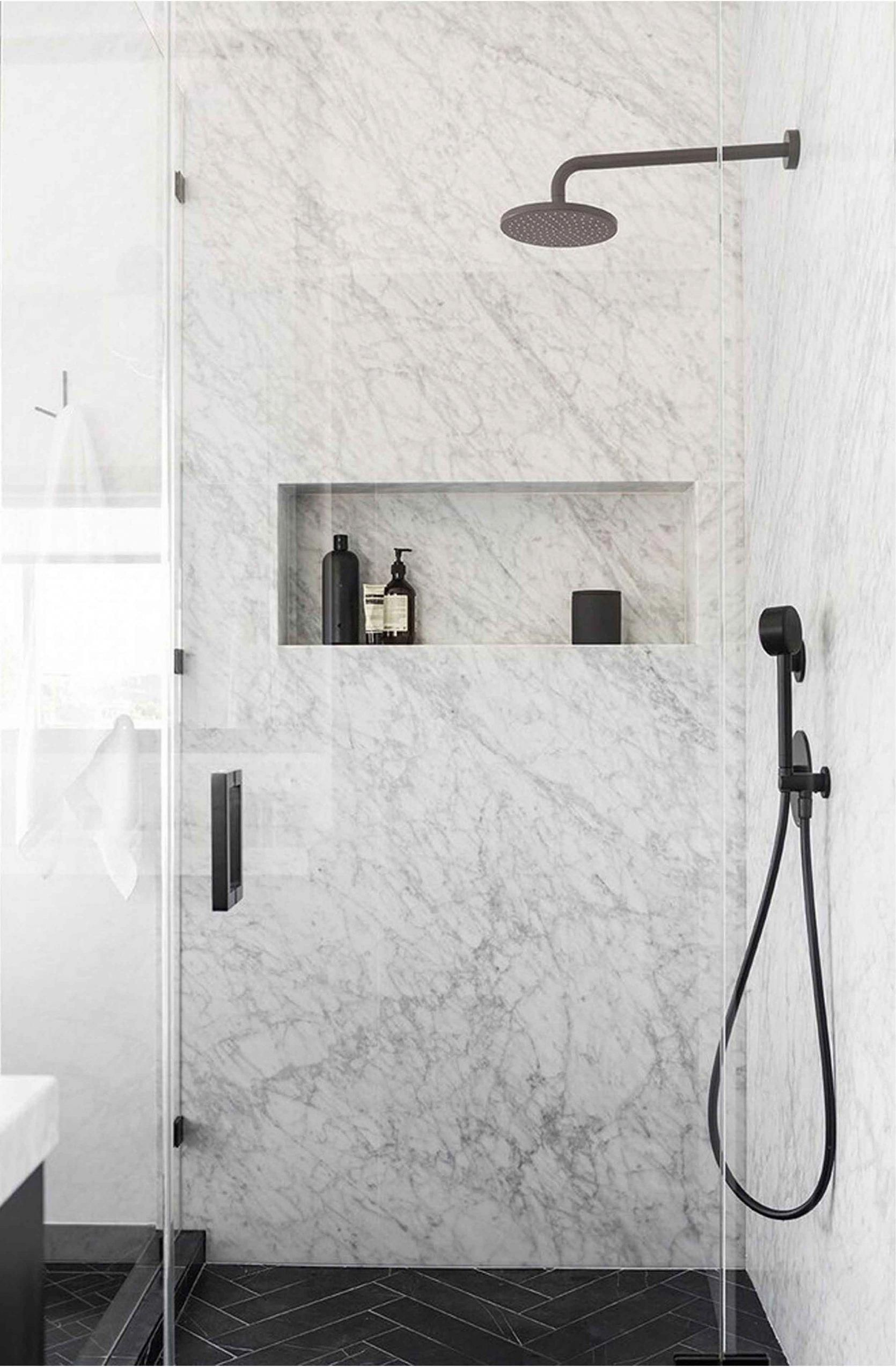 Slab Marble Shower With Horizontal Niche And Black Fixtures With