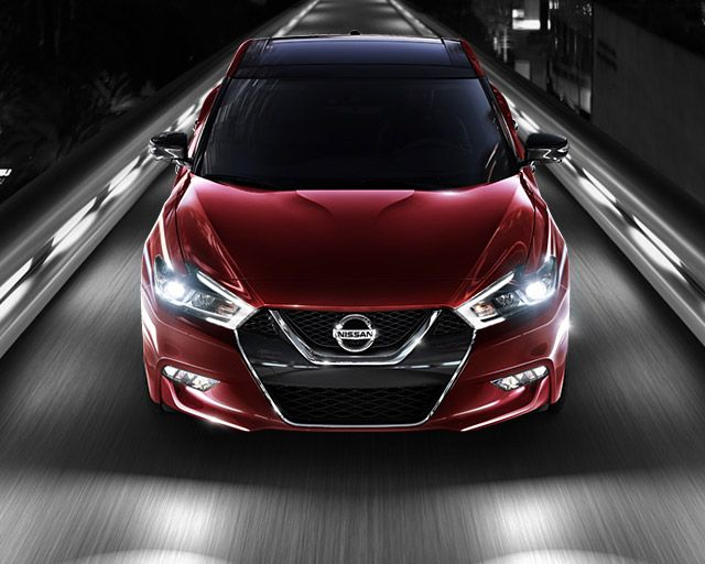 2017 Nissan Maxima Sedan Shown In Coulis Red From A Front Angle Driving On An Illuminated Road In The City At Night Nissan Maxima Nissan Cars Nissan