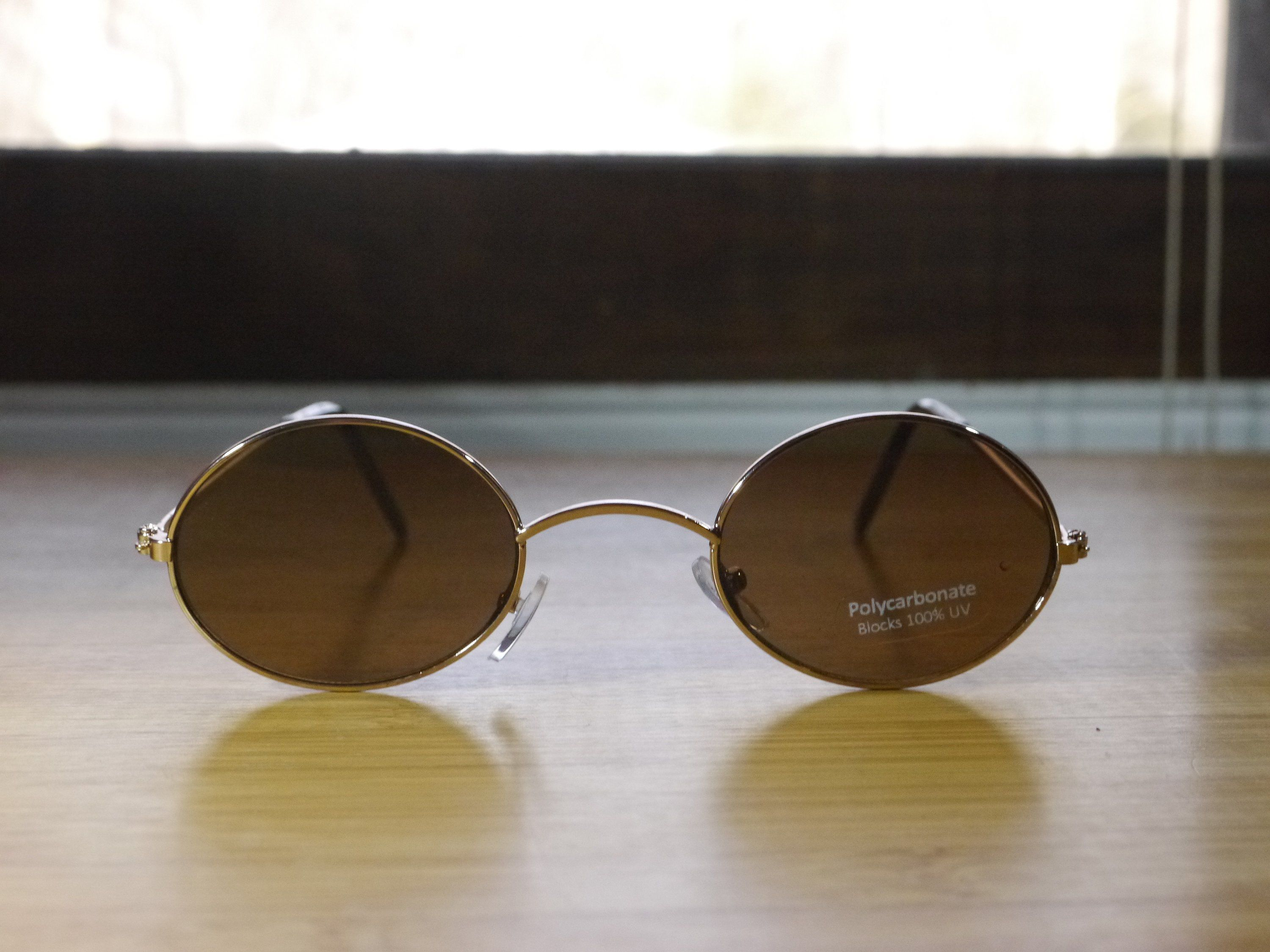 72af6a3369a Gold Frames   Brown Lenses. Compact Retro