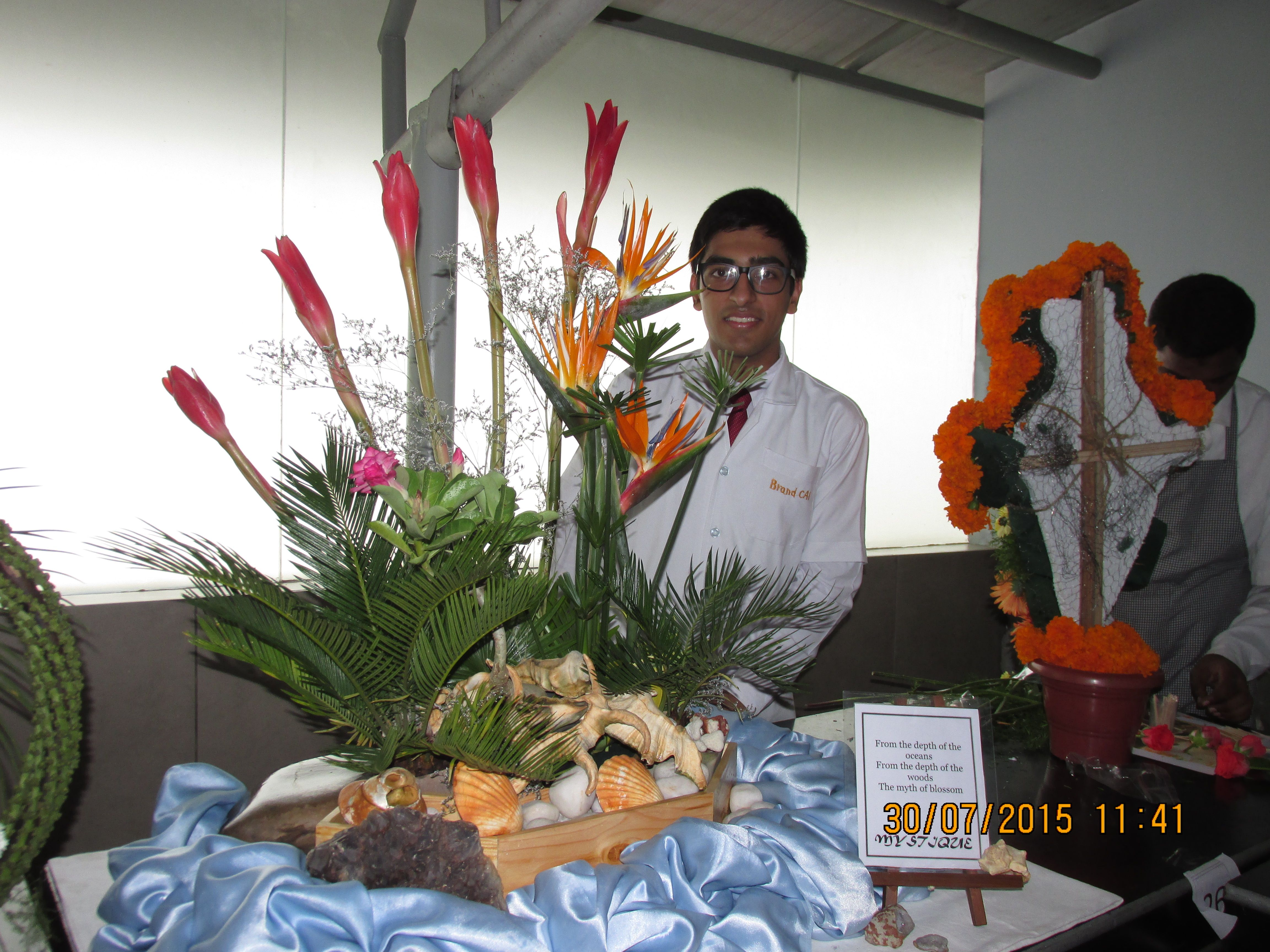 cai wins silver medal for flower arrangement competition at acp association of catering professionals held - Silver Hotel 2015