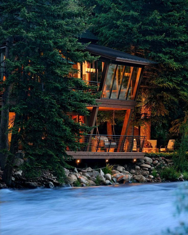 Modern treehouse suspended over a roaring river in Old Snowmass is part of Modern Treehouse Suspended Over A Roaring River In Old Snowmass - A modern interpretation of a treehouse, this rustic riverfront home was designed by David Johnston Architects, located in the mountains of Old Snowmass, Colorado