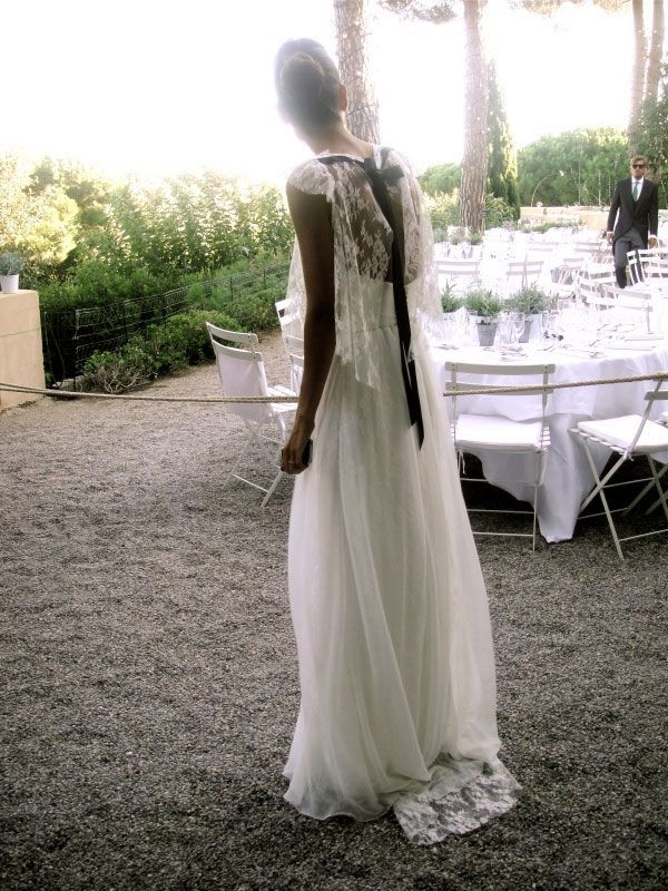 Love this romantic wedding dress. Lace flutter / capelet sleeves