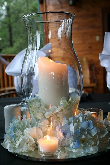 Cocktail Table Idea But Using Blue Stones Marbles And Yellow Petals Hurricane Centerpiece Wedding Centerpieces Wedding Decorations