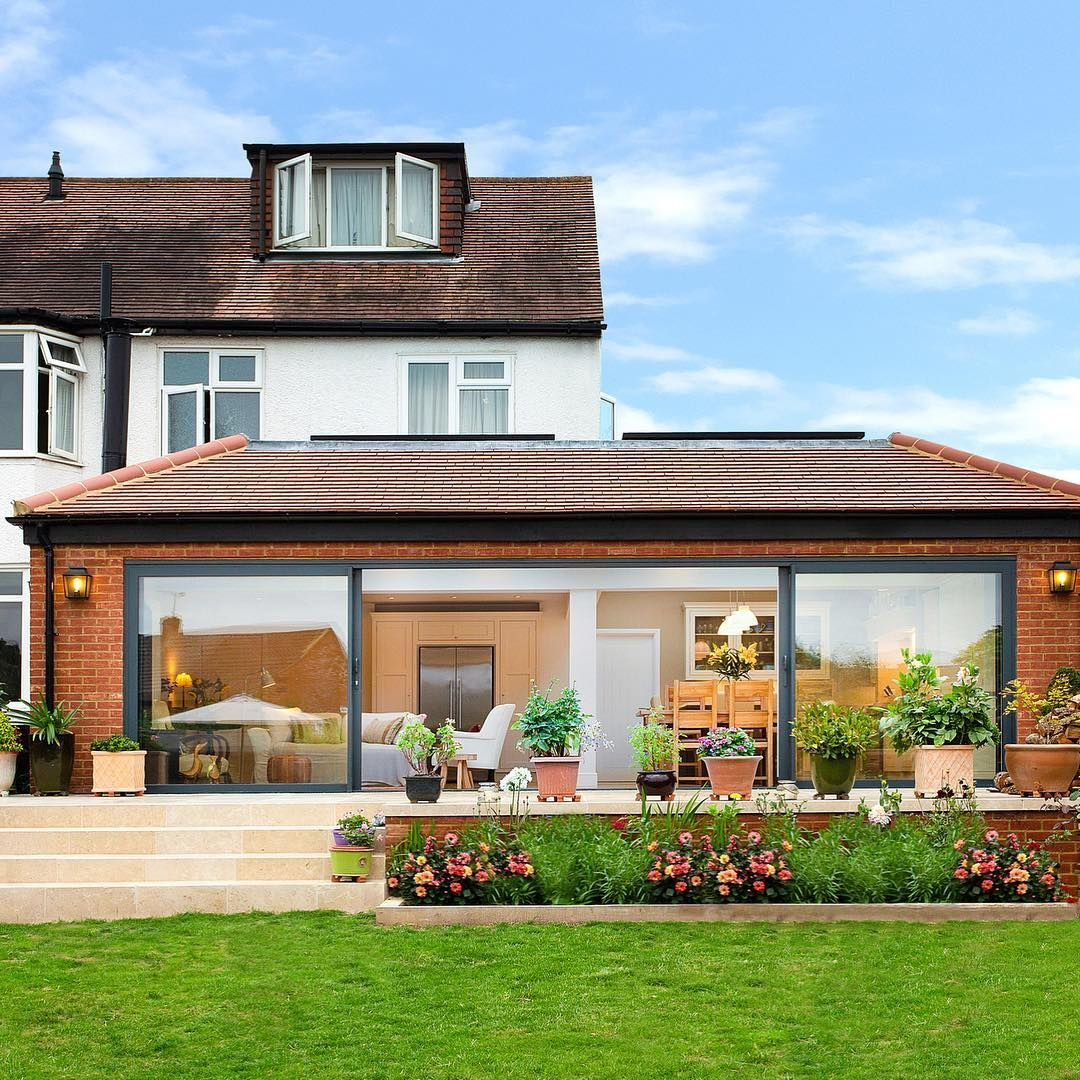 A Wide Crown Roof Extension Wraps Around The Side Of This Property And Opens Up Not Only To Acc In 2020 Roof Extension Garden Room Extensions Exterior House Renovation