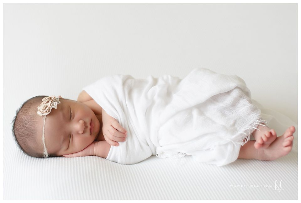 Natural newborn images using soft neutral tones in a minimalistic style in home newborn photos greenwich and fairfield county photographer kelli dease