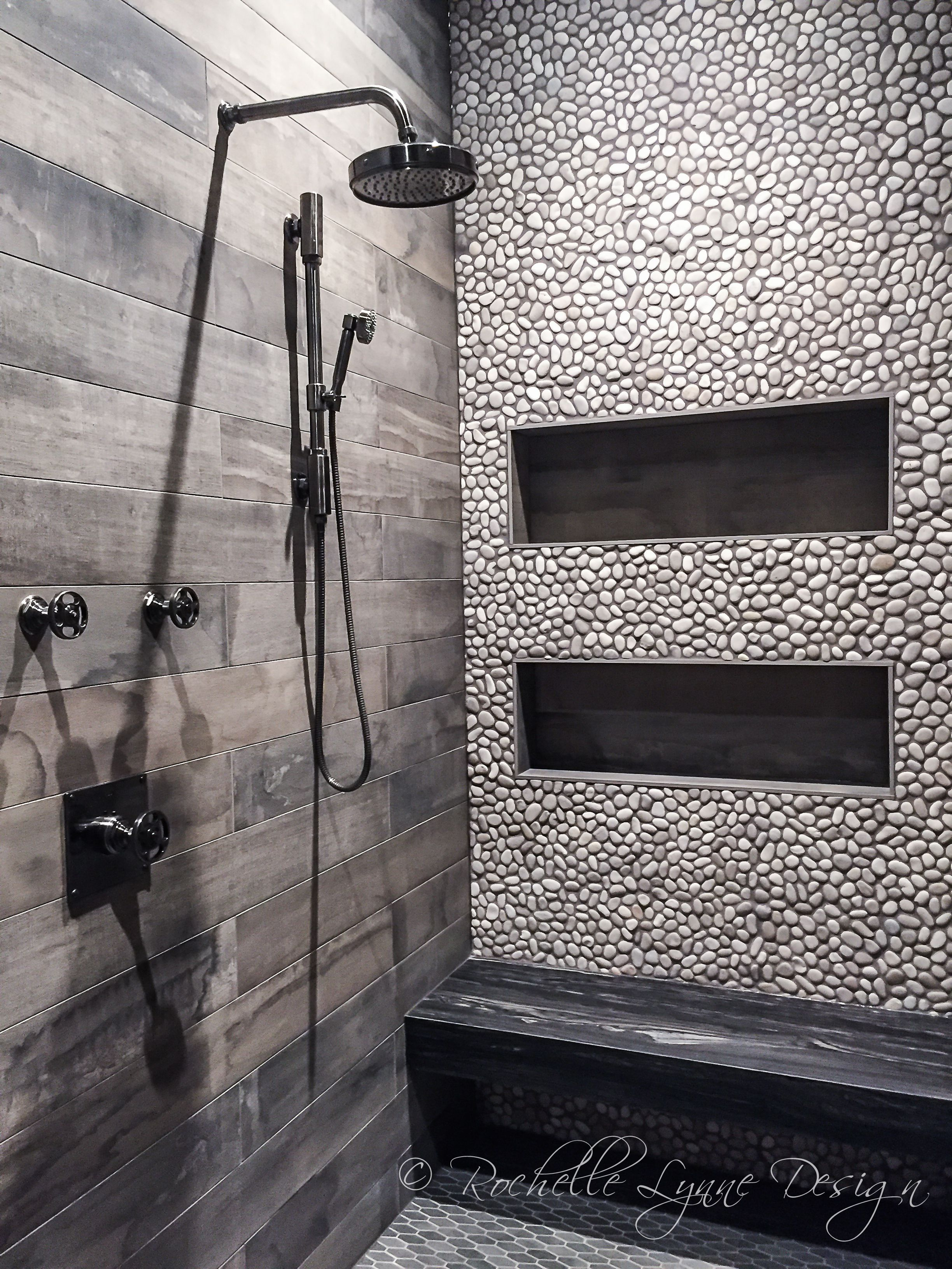 Wood look tile and pebbles in shower, bench seat of stone, large shower niches | Design by Rochelle Lynne Design, Cochrane, AB