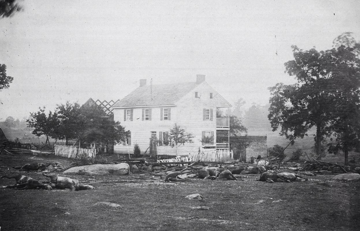 Dead horses at the damaged Trostle House, Generals Meade and Sickles headquarters, after the battle of Gettysburg.
