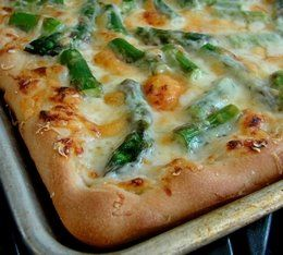 Here is what I used for this pizza:  1 batch of dough  some cornmeal for the pan  1 pound of asparagus, cut and boiled for 1 minute  1 cup of bechamel (white sauce) to which I added 1/3 cup grated parmesan  4 oz shredded white cheddar  1/3 cup parmesan for the top