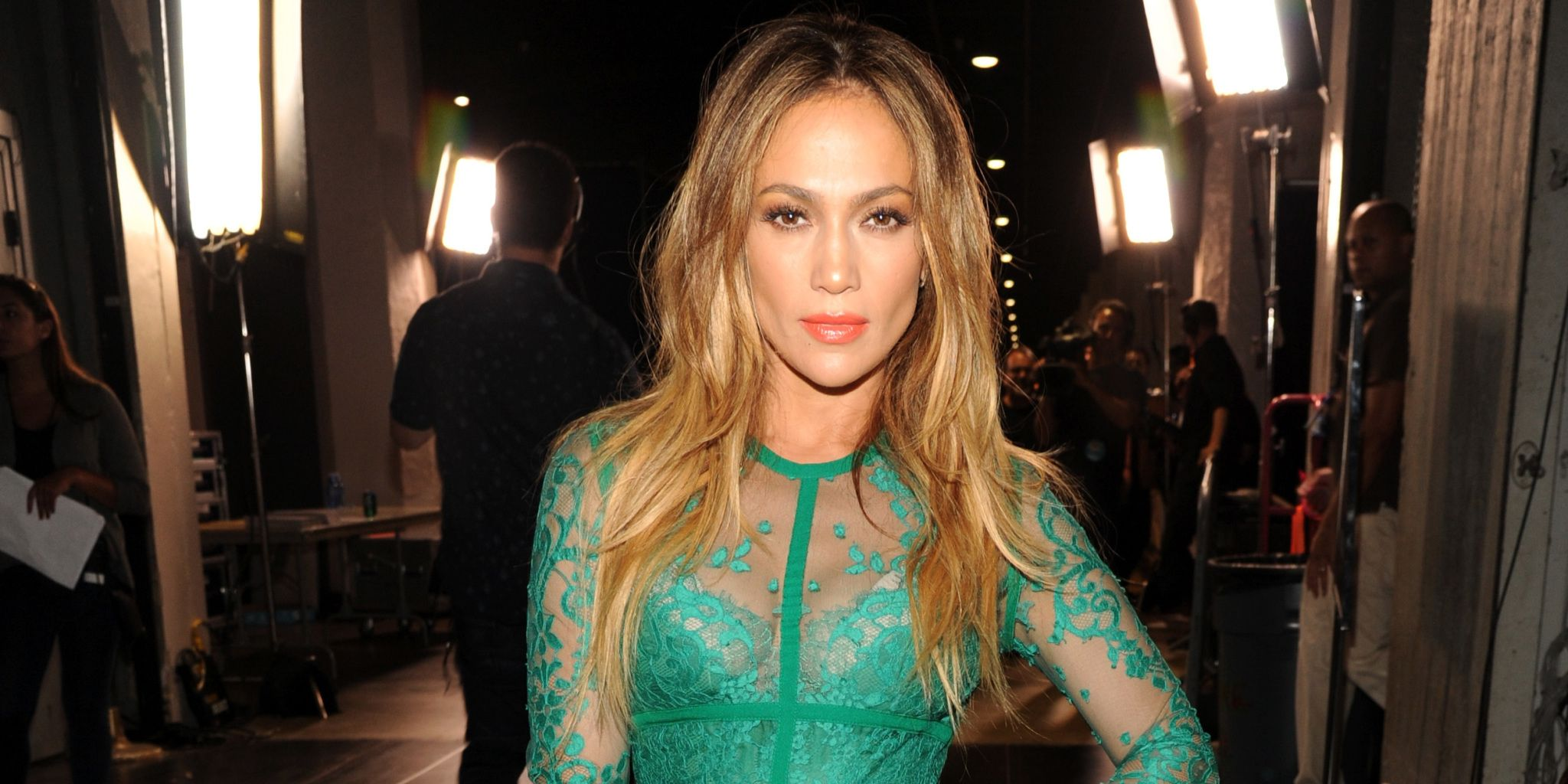 Jennifer Lopez wearing green lace dress at the 2014 Teen Choice Awards - celebrity style photos - fashion - cosmopolitan.co.uk -Cosmopolitan.co.uk