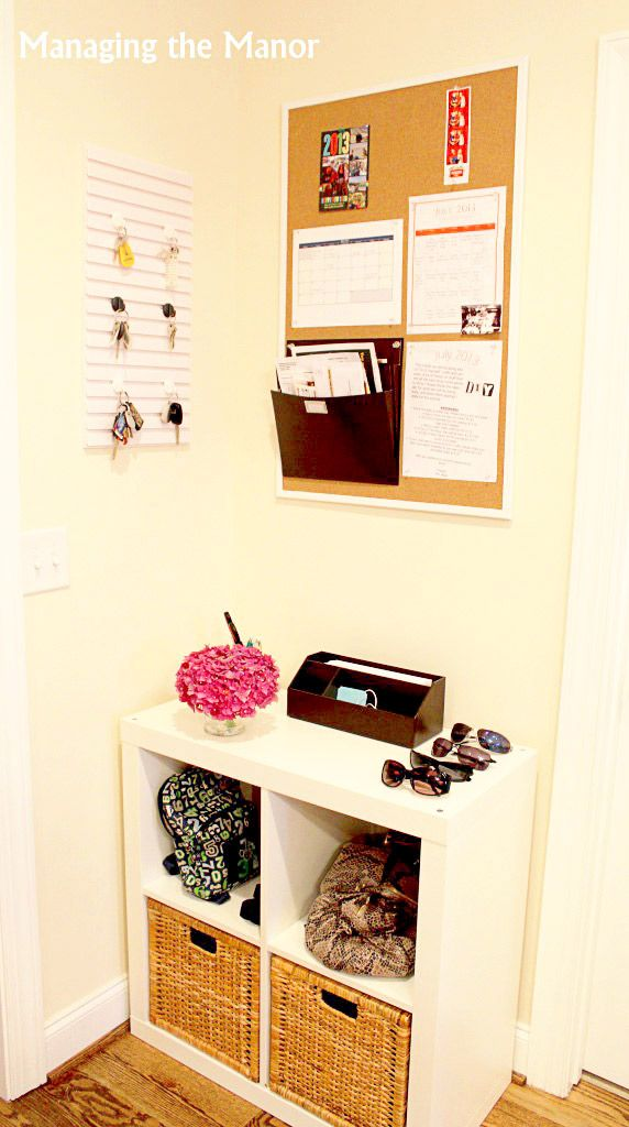 Create a command center to organize your entryway -- such a great idea, and it only takes up a small space! Catch clutter BEFORE it spreads through your house -- mail, shoes, bags, toys, keys, and everything else!  #organize #entry #diy