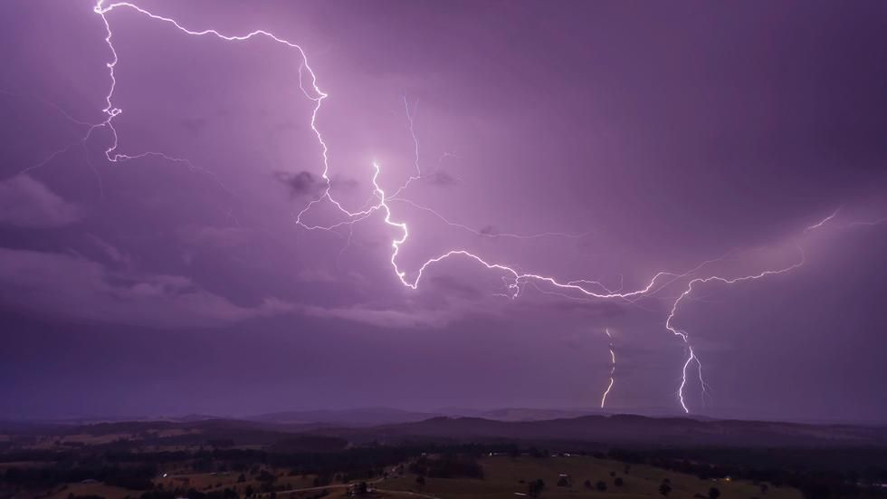 Andrea Evans, of Girvan, New South Wales, Australia, photographed colorful lightning storms from the top floor of her 10-story building, between 2013 and 2016. (Andrea Evans/Solent News)