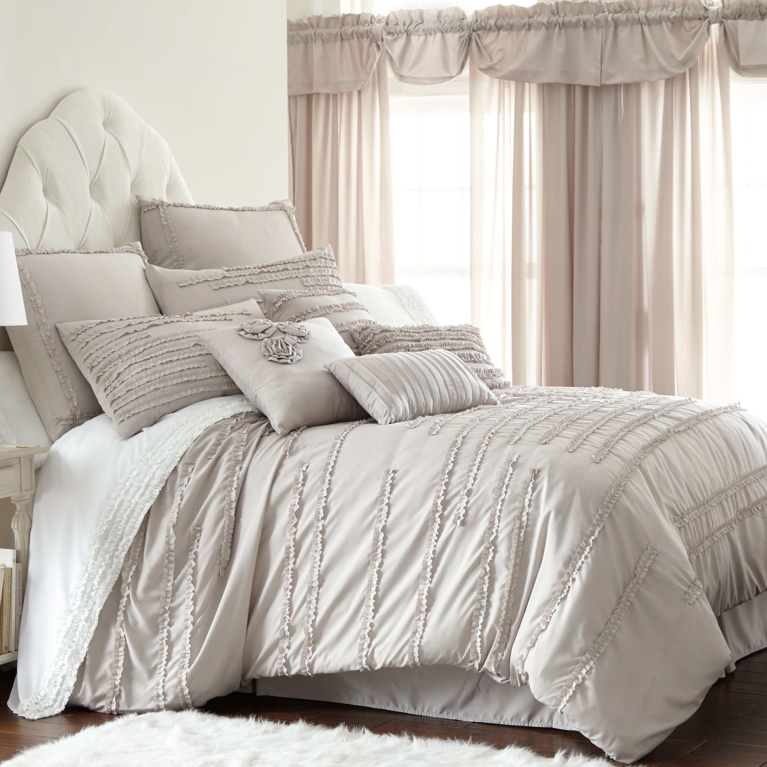 A Ruffled Look With A Rose Detail Adorns This Polyester Comforter
