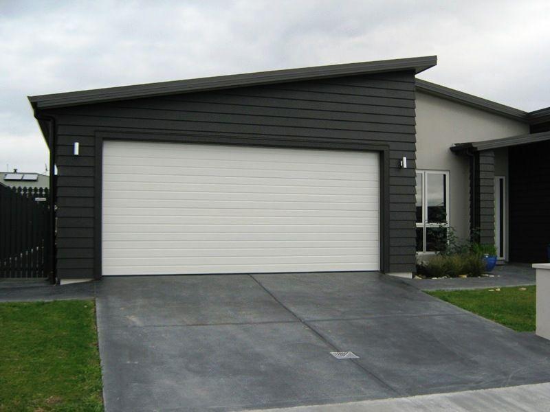 Nice garage doors insulated 5 modern garage doors for Insulated front doors for homes