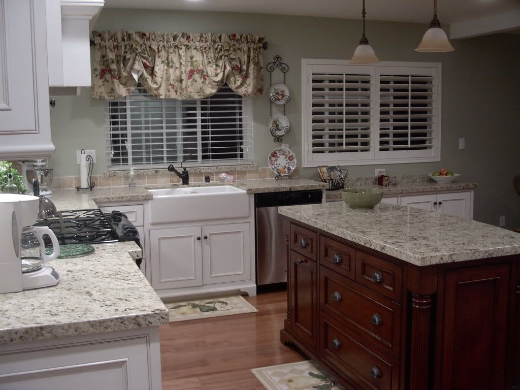 Like This Granite Santa Cecilia Light With White Cabinets
